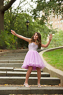 Portrait of a 13 year old girl in party dress photographed in Riverside Park.