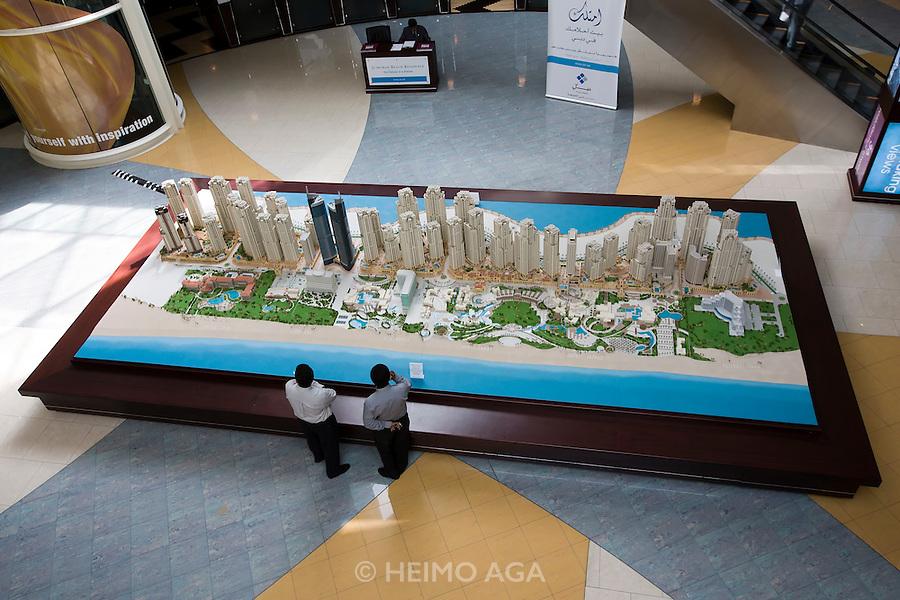 Sheikh Zayed Road. Emirates Towers Hotel. Model of Dubai Marina development in the basement.