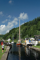 A yacht passing through the locks at Cairnbaan on the Crinan Canal, Argyll &amp; Bute, Scotland<br /> <br /> Copyright www.scottishhorizons.co.uk/Keith Fergus 2011 All Rights Reserved