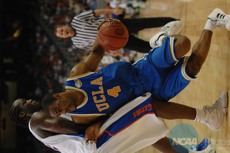 31 MAR 2007: Arron Afflalo (4) of the University of California - Los Angeles drives into Chris Richard (32) of the University of Florida during the NCAA Men's Division I Basketball Championship semifinal game at the Georgia Dome in Atlanta, GA. Florida defeated UCLA 76-66 to advance to the final game. Stephen Nowland/NCAA Photos
