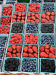 A variety of berries are boxed for sale at a farmer's market. (DOUG WOJCIK MEDIA)