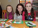 Kelly Ferris, Olivia Smith and Holly Heeney pictured at the St. Patrick's Art workshop held in the library. Photo: Colin Bell/pressphotos.ie
