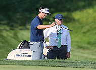 Potomac, MD - July 1, 2018: Beau Hossler talks to a rules official before he takes a shot during final round at the Quicken Loans National Tournament at TPC Potomac  in Potomac, MD, July 1, 2018.  (Photo by Elliott Brown/Media Images International)