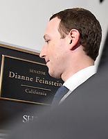 Surrounded by staff and security, Mark Zuckerberg, Co-Founder and Chief Executive Officer of Facebook, walks to United States Senator Dianne Feinstein's (Democrat of California) office as he makes the rounds on Capitol Hill prior to giving testimony before Congress on Tuesday and Wednesday on Monday, April 9, 2018<br /> CAP/MPI/RS<br /> &copy;RS/MPI/Capital Pictures