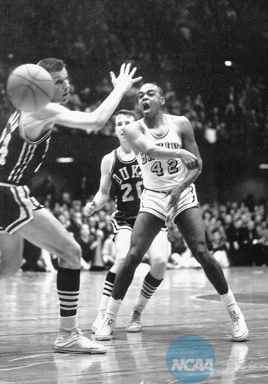 21 MAR 1964:  UCLA guard Walt Hazzard (42) pass the ball past Duke forward Jack Marin (24) with Duke guard Denny Ferguson (20) background during the NCAA National Basketball Final Four championship game held in Kansas City, MO at the Municipal Auditorium. UCLA defeated Duke 98-83 for the title. Photo By Rich Clarkson