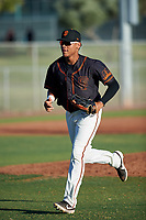 AZL Giants Black Bryan Hernandez (23) jogs off the field between innings of an Arizona League game against the AZL Angels at the Giants Baseball Complex on June 21, 2019 in Scottsdale, Arizona. AZL Angels defeated AZL Giants Black 6-3. (Zachary Lucy/Four Seam Images)