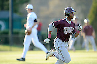 Center fielder Morgan Phillips (15) of the College of Charleston Cougars runs to first in a game against the University of South Carolina Upstate Spartans on Tuesday, March 31, 2015, at Cleveland S. Harley Park in Spartanburg, South Carolina. Charleston won, 10-0. (Tom Priddy/Four Seam Images)