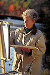 elder woman painting landscape outside