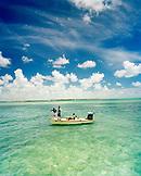 USA, Florida, three men on nautical vessel, fishing for Tarpon, Ivory Keys
