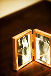 photos of 1950s married couple in gold frame