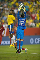 Portugal goalkeeper Rui Patricio  (12) leaps to save the ball as Brazil forward Jo (21) attempts to head it into goal.  In an International friendly match Brazil defeated Portugal, 3-1, at Gillette Stadium on Sep 10, 2013.