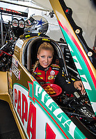 Oct 15, 2016; Ennis, TX, USA; NHRA top fuel driver Leah Pritchett holds a slice of Papa John's new pan pizza in the cockpit of her Papa John's dragster with her new Dallas Cowboys themed racing helmet during qualifying for the Fall Nationals at Texas Motorplex. Mandatory Credit: Mark J. Rebilas-USA TODAY Sports