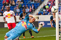 New York Red Bulls goalkeeper Luis Robles (31) dives for a shot. The New York Red Bulls defeated the Philadelphia Union 2-1 during a Major League Soccer (MLS) match at Red Bull Arena in Harrison, NJ, on March 30, 2013.