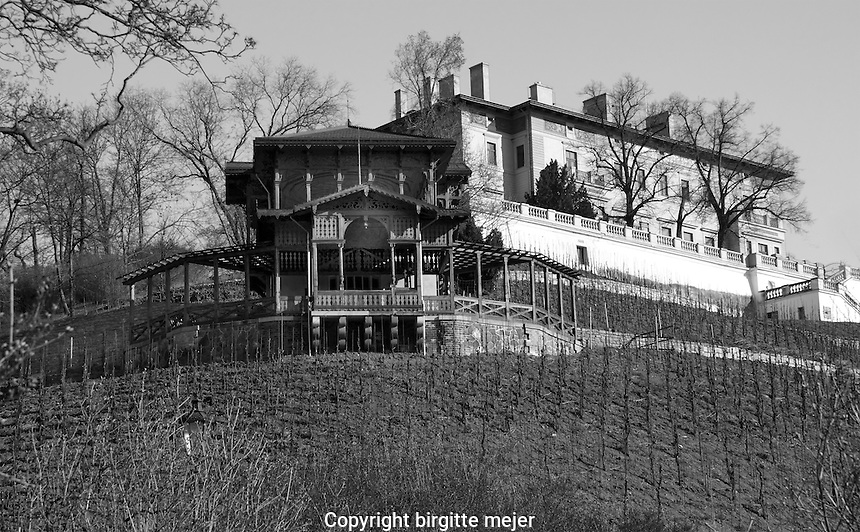 Photo of the Grebovka Villa, taken from below, with the wine ranks in the front.