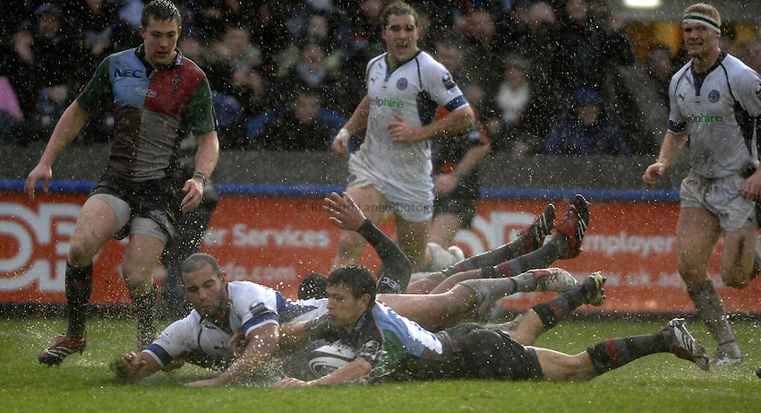 Photo: Richard Lane..NEC Harlequins v Bath Rugby. Guinness Premiership. 06/01/2007. .Quins' Danny Care dives in for a dissallowed try as Bath's Chev Walker challenges.