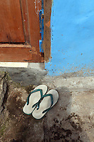 Flip-flops outside of a home in central Jakarta.<br /> <br /> To license this image, please contact the National Geographic Creative Collection:<br /> <br /> Image ID:  1588055<br />  <br /> Email: natgeocreative@ngs.org<br /> <br /> Telephone: 202 857 7537 / Toll Free 800 434 2244<br /> <br /> National Geographic Creative<br /> 1145 17th St NW, Washington DC 20036