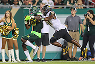 Tampa, FL - September 2, 2016: South Florida Bulls wide receiver Rodney Adams (87) gets tackled by Towson Tigers defensive back Jordan Floyd (21) during game between Towson and USF at the Raymond James Stadium in Tampa, FL. September 2, 2016.  (Photo by Elliott Brown/Media Images International)