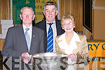 CUP: Gerry Savage (Ballymacelligott), Pat King (Fenit) and Louise O'Leary (Tralee) get to hold the Sam Maguire Cup at the Kerry Supporters Club Dinner Dance at Ballygarry House, Tralee, on Saturday night..