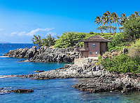 A distant visitor jumps into the water near the Cliff House, as seen near the Kapalua Coastal Trail in Kapalua, Maui.