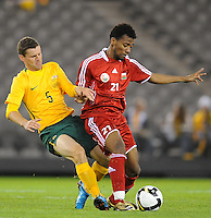 MELBOURNE, AUSTRALIA - OCTOBER 14: Jason Culina from Australia tackles Ahmed Hadid from Oman in a AFC Asian Cup 2011 match between Australia and Oman at Etihad Stadium on October 14, 2009 in Melbourne, Australia. Photo Sydney Low www.syd-low.com