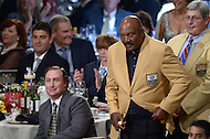 Canton, Ohio - August 1, 2014: NFL great and 1971 Hall of Fame Inductee Jim Brown is recognized during the Pro Football Hall of Fame's class of 2014 enshrinement dinner in Canton, Ohio  August 1, 2014. Brown made nine Pro Bowl appearances and had a career high 15,459 combined net yards gained. (Photo by Don Baxter/Media Images International)