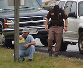 """Fredericksburg, VA - October 11, 2002 -- Spotsylvania County Police search the scene along Route 1 near I-95 where a man was shot and killed at an Exxon Station this morning.  Police have not determined if this shooting is connected with the """"Beltway Sniper"""" shootings that have terrorized the National Capital Area.<br /> Credit: Ron Sachs / CNP<br /> (RESTRICTION: NO New York or New Jersey Newspapers or newspapers within a 75 mile radius of New York City)"""