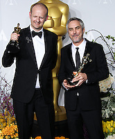 HOLLYWOOD, LOS ANGELES, CA, USA - MARCH 02: Mark Sanger, Alfonso Cuaron at the 86th Annual Academy Awards - Press Room held at Dolby Theatre on March 2, 2014 in Hollywood, Los Angeles, California, United States. (Photo by Xavier Collin/Celebrity Monitor)