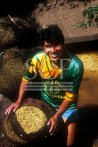 Quillabamba, Peru. Portrait of a man in a COCLA co-operative football shirt; COCLA coffee co-operative.