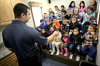 NWA Democrat-Gazette/DAVID GOTTSCHALK  Tyler McCartney, assistant fire marshal with the Washington County Sheriff's Office, participates Wednesday, October 11, 2017, in a virtual fire safety drill with second grade students in Jessica Breshears' class at Sonora Elementary School. McCartney, Will Hewat (cq), assisting (cq) the Washington County Sheriff's Office Fire Mashall Division, and Gary Hull, Chief of the Nob Hill Fire Department, were visiting the school promoting Fire Prevention Week and teaching children fire prevention and safety. The students participated in a the virtual safety drill, experienced the Fire Prevention and Life Safety Trailer and toured the Nob Hill Fire Department Heavy Rescue unit.