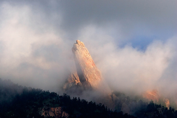 The Third Flatiron rock formation rising above the fog, Boulder, Colorado. .  John leads private photo tours in Boulder and throughout Colorado. Year-round. .  John leads private photo tours in Boulder and throughout Colorado. Year-round Colorado photo tours.