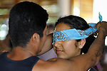 A woman gets a blindfold placed on her head as a group of university students learn about disability by having individual disabilities imposed on them during a sensitivity training session at Piña Palmera, a community based rehabilitation program in Zipolite, a town in Oaxaca, Mexico.
