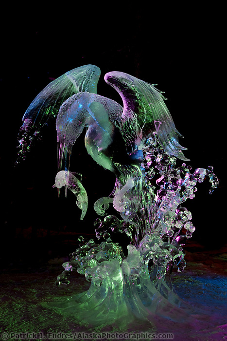 "Japanese artists Junichi Nakamura and Suguru Kanbayashi. Single block, realistic sculpture titled ""Surfacing Kingfisher"" First place realistic category, 2009 World Ice Art Championships in Fairbanks, Alaska."