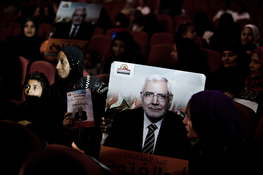 Supporters of progressive candidate Dr Abdel Moneim Aboul Fotouh hold a poster of him at a campaign event in Cairo, May 15, 2012. Photo: ED GILES.