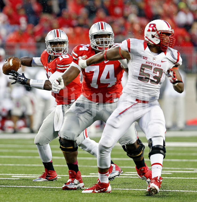 Ohio State Buckeyes offensive lineman Jamarco Jones (74) protects Ohio State Buckeyes quarterback J.T. Barrett (16) against Rutgers Scarlet Knights during the 4th quarter of their game at Ohio Stadium on October 18, 2014.  (Dispatch photo by Kyle Robertson)