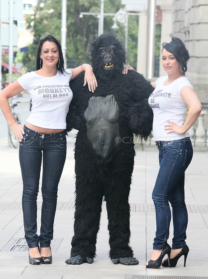 """NO REPRO FEE. 15/9/2010. John J. May launches his controversial book """"The Origin of Specious Nonsense"""" outside the Dail in Dublin.  Pictured are a gorrila, Joan Fitzgerald and Janine Clancy. The launch will then commences at 7pm in Buswells hotel where he delivers his talk: """"How evolution made monkeys out of man""""Picture James Horan/Collins Photos"""
