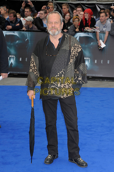 Terry Gilliam.'Prometheus' world film premiere, Empire cinema, Leicester Square, London, England..31st May 2012.full length black trousers umbrella beard facial hair grey gray pattern print jacket.CAP/PL.©Phil Loftus/Capital Pictures.