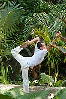 A yoga teacher in the 'natarajasana' pose at the Maia Luxury Resort & Spa