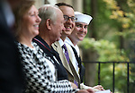 From left, Pam Robinson, Dr. Craig Bell, Dr. Joe Uccelli and MMI Keith Kaiser listen to a speaker at the USS Nevada Centennial of Launch ceremony at the Capitol, in Carson City, Nev., on Friday, July 11, 2014.<br /> Photo by Cathleen Allison