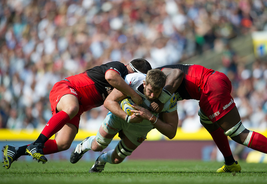 Geoff Parling of Exeter Chiefs is tackled by Jamie George of Saracens (left) and Maro Itoje<br /> <br /> Photographer Ashley Western/CameraSport<br /> <br /> Rugby Union - Aviva Premiership Final - Saracens v Exeter Chiefs - Saturday 28th May 2016 - Twickenham Stadium, Twickenham, London  <br /> <br /> World Copyright &copy; 2016 CameraSport. All rights reserved. 43 Linden Ave. Countesthorpe. Leicester. England. LE8 5PG - Tel: +44 (0) 116 277 4147 - admin@camerasport.com - www.camerasport.com