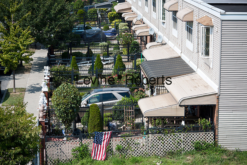 Attached homes with gardens in the East New York neighborhood of Brooklyn in New York are seen on Saturday, September 1, 2012. (© Richard B. Levine)