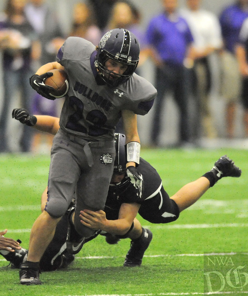 NWA Democrat-Gazette/ANDY SHUPE<br /> Luke Rapert (22) of Fayetteville is hit Friday, May 29, 2015, near the goal line during the Bulldogs' annual Spring Game inside the school's indoor facility in Fayetteville. Visit nwadg.com/photos to see more photographs from the game.
