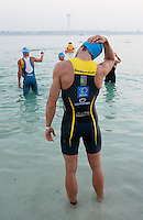 13 MAR 2010 - ABU DHABI, UAE - Victor Manuel Del Corral Morales stretches before the start of the Abu Dhabi International Triathlon (PHOTO (C) NIGEL FARROW)