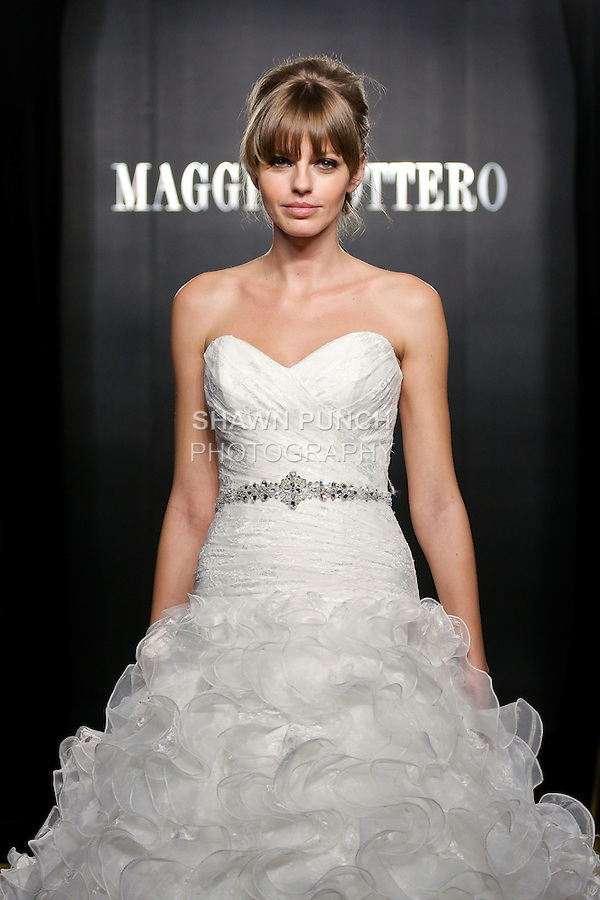 Model walks the runway in a Lilith Haute Couture wedding dress from the Maggie Sottero Bridal Spring 2012 collection, during  Couture: New York Bridal Fashion Week 2012