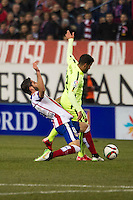 Atletico de Madrid´s Raul Garcia and Barcelona´s Daniel Alves during 2014-15 Spanish King Cup match between Atletico de Madrid and Barcelona at Vicente Calderon stadium in Madrid, Spain. January 28, 2015. (ALTERPHOTOS/Luis Fernandez) /nortephoto.com<br />