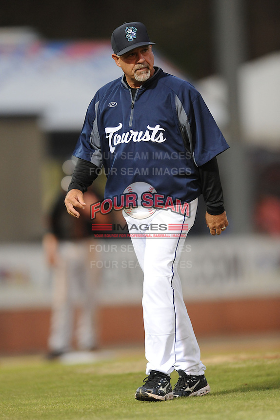 Asheville Tourists pitching coach Mark Brewer #17 during a game against the Delmarva Shorebirds at McCormick Field on April 4, 2014 in Asheville, North Carolina. The Shorebirds defeated the Tourists 7-2. (Tony Farlow/Four Seam Images)