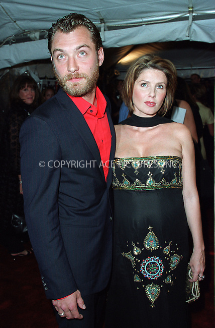 """Jude Law with wife Sadie Frost attending a special screening of """"Road to Perditon"""" to benefit the Association of the HITWG Camps and the International Rescue Committee. New York, July 9, 2002.  Please byline: Alecsey Boldeskul/NY Photo Press.   ..*PAY-PER-USE*      ....NY Photo Press:  ..phone (646) 267-6913;   ..e-mail: info@nyphotopress.com"""