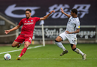 Bristol City's Zak Vyner (left) crosses the ball despite the attentions of  Swansea City's Rhian Brewster (right) <br /> <br /> Photographer David Horton/CameraSport<br /> <br /> The EFL Sky Bet Championship - Swansea City v Bristol City- Saturday 18th July 2020 - Liberty Stadium - Swansea<br /> <br /> World Copyright © 2019 CameraSport. All rights reserved. 43 Linden Ave. Countesthorpe. Leicester. England. LE8 5PG - Tel: +44 (0) 116 277 4147 - admin@camerasport.com - www.camerasport.com