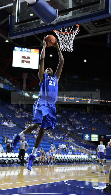 Perry Stevenson, a former UK basketball player, makes a shot against Coach Cal's Fantasy camp participants during the University of Kentucky's alumni basketball game in Rupp Arena in Lexington, Ky., on Sunday, September 8, 2013. Photo by Eleanor Hasken | Staff