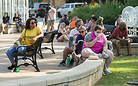 Guests listen to speakers Friday, June 19, 2020, during a Juneteenth cookout at Lawrence Plaza in Bentonville. Go to nwaonline.com/200620Daily/ to see more photos.<br /> (NWA Democrat-Gazette/Ben Goff)
