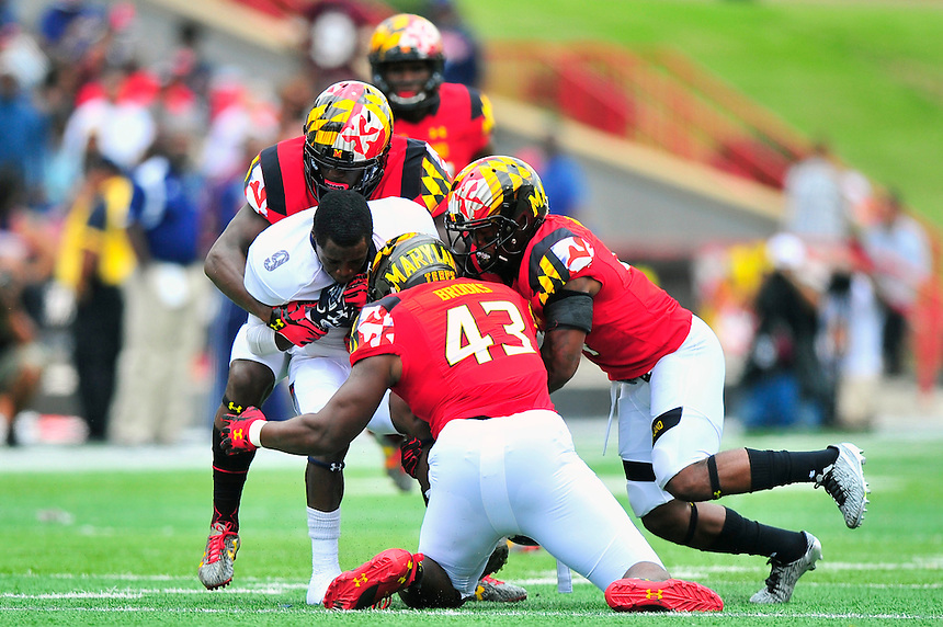 Bison's Jalen Avery loses his helmet after a collision. Maryland routed Howard 52-13 during home season opener at Capital One Field in College Park, MD on Saturday, September 3, 2016.  Alan P. Santos/DC Sports Box